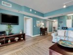 Living area with a queen sleeper sofa, balcony access & beautiful views!