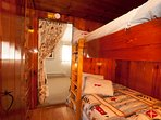 Knotty Pine bunk-bed alcove with double beds