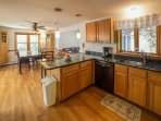 Boasting granite countertops and stainless steel appliances, this kitchen makes cooking for large groups a breeze.