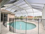 Cool off in the private screened-in pool complete with fencing for added protection for families.