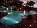 Night view of the pool area with a tiki torches lit!