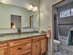 An upgraded shower/tub combo is found in this second full bathroom.