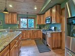 Stainless steel appliances and granite countertops give the kitchen a polished look!