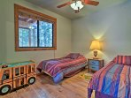 Kids can sleep peacefully in the twin beds provided in this bedroom.