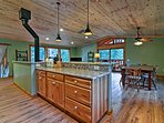 You'll be able to see the Vermont Castings wood-burning stove from the fully equipped kitchen.