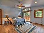 This spacious master bedroom features a queen bed and direct access to the viewing deck.