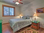 Two travelers will be able to cozy up in this comfortable queen bed.