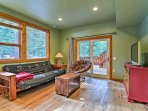 A queen-sized futon is provided in the downstairs den to host up to 2 travelers.