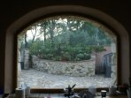 Here's only part of what you see from the spacious kitchen- herb garden, olive trees & the entry.