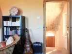 Enter into the Suite Zafferano Living Room, once a music room for the locals, now a Formal Living..