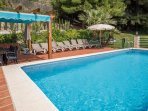 Private swimming pool with sun loungers