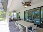 Three different seating options on the lanai and overhead fans