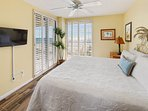 Serene master bedding with a king bead leading onto the wrap around balcony.