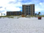 View of Emerald Isle Complex from beach. Our unit is in the middle of the building on the left.