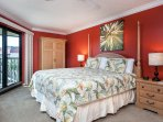The large master bedroom has a king bed and ample room.
