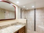 From the master vanity you walk into the custom designed bathroom with a huge walk-in shower!