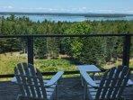 Adirondack chairs on wraparound deck