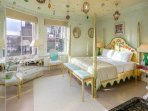 Fantastic master bedroom with a four post bed