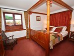 Four-poster double with en-suite with shower over bath