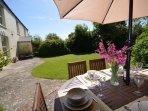 Enjoy al fresco dining in the spacious, enclosed garden