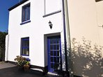 The property is located at the end of a quiet, narrow street