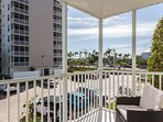 Brand new, comfortable club seating for two on the screened lanai. You can relax and watch the activity around the...