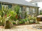 The property with lovely well established gardens to relax in