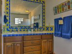 Freshen up in this colorful bathroom brimming with Mexican style and charm.
