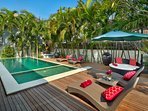 Exquisite L-shape pool with large wooden deck