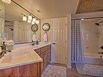 The Jack-and-Jill en-suite bathroom offers a shower/tub combo.