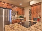 The newly updated kitchen boasts stainless steel appliances.