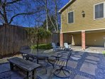 Enjoy a meal alfresco in the spacious backyard as the kids play in the large yard.
