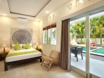 King size bed on one of the bedrooms with easy access to the pool