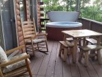 Hot tub is right by the door for easy access and wonderful views. Enjoy the stars at night, too.
