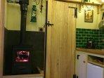 Log burner and door to bathroom