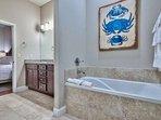 Deep soaking tub in the master bathroom