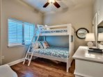 The third bedroom has a full bottom bunk and twin top