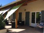 Covered terrace leading from kitchen for el fresco dining & shade !