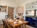 Kitchen space with Aga, cooker, fridge and dishwasher