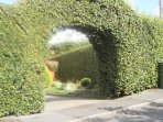 Beech arch into the property: parking on drive for 2 cars