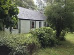 The Cottage is centrally located in a peaceful rural setting but not far from amenities.
