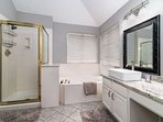 Master Bath has garden tub and stand-alone shower