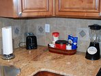 Toaster, coffee supplies, and blender