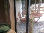Luxury bathroom with design sink overlooking a private zen garden.