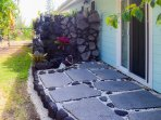 Downstairs bedroom's lava rock lanai