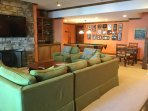 Terrace level family room with pool and game tables