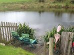 Decking area at bottom of garden for guests to fish