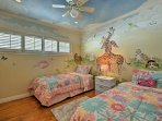 Kids adore the second bedroom with children's decorations on the walls and ceiling.