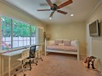 The third bedroom serves as an office and additional sleeping space for 1 on the twin bed.
