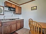 The kitchenette is well-equipped with a mini-fridge, microwave and 2-burner stove.